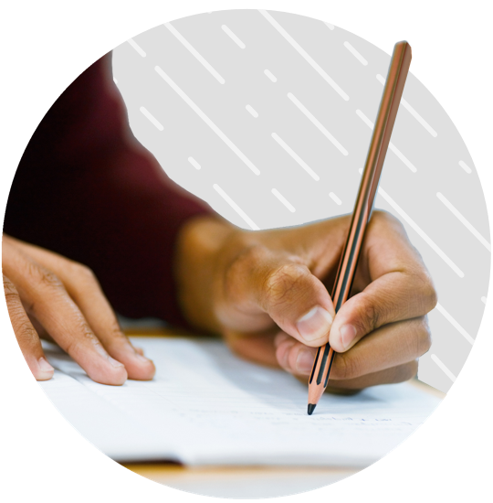 Person filling out questionnaire with pencil in hand